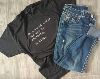 In a world where you can be anything be kind. Charcoal gray T-shirt!