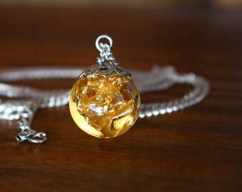 Gold leaf necklace in resin ball