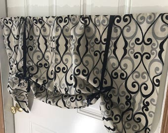 Tan and black scroll tie up window valance