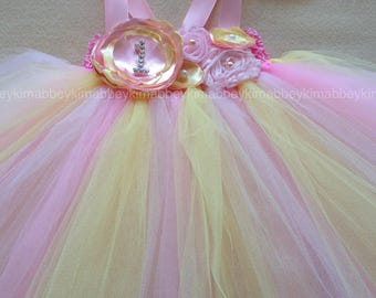Beautiful babygirl strawberry pinklemonade tutudress ,firstbirthdaytutudress in pink and yellow withmatching headband for girls 12-18 months