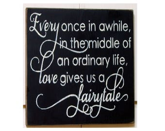 Once in a while in the middle of an ordinary life love gives us a fairytale wood sign