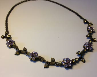 Purple and pink flowers necklace.