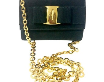 Vintage Salvatore Ferragamo black leather shoulder mini bag with golden chain and Vara bow motif. Clutch purse from Vara collection.