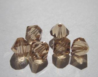 6 genuine swarovski 6 mm Crystal bicones - peach (65)