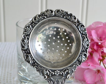 Ornate tea strainer with sailboat top, vintage Swedish silver plate