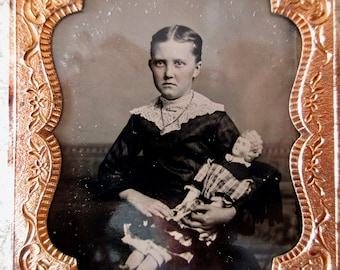 antique sixth plate tintype photo - 1800s, little girl with china doll, pouty face, half case