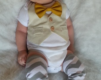 Baby Boy Bodysuit With An Ivory Linen Vest Attached, A Mustard Yellow Bow Tie And Matching Leg Warmers set.