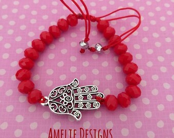 Adjustable bracelet with Hamsa hand and crystals. Adjustable bracelet with hamsa hand and crystals.
