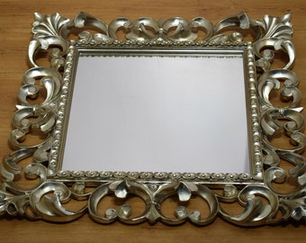 Mirror in carved wood with a classic frame, antique silver finish made in Italy