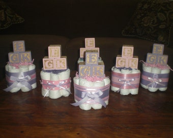 Pink and Purple Baby Shower Centerpieces Diaper cakes other sizes and colors too