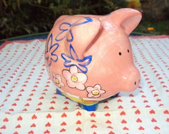 Painted ceramic pig piggy bank.