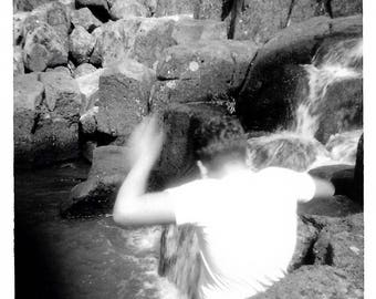 "Vintage Snapshot ""Cliff Diver"" Young Boy Jumps Into Falling Water Blur Motion Back To Camera Faceless Found Vernacular Photo"