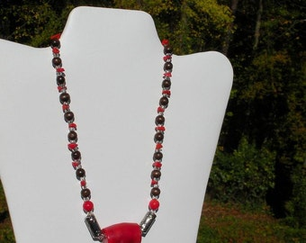 Red coral necklace with brown wooden beads