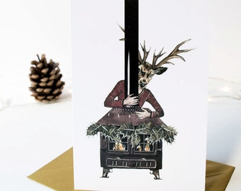 Christmas card featuring an anthropomorphic reindeer stag with a holly decorated fireplace. Greeting note card. Blank inside
