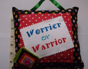 Small cushion with saying Worrier or Warrior 20 cm x 18cm