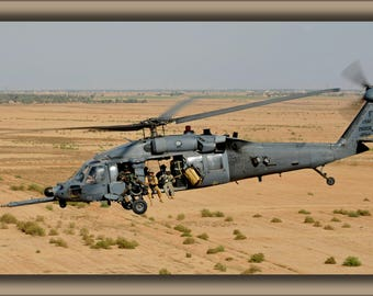 Poster, Many Sizes Available; Hh-60 Pave Hawk Helicopter Carrying Pararescuemen Iraq 2009