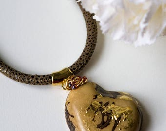 Half Tagua Nut with a splash of Gold.(0223)