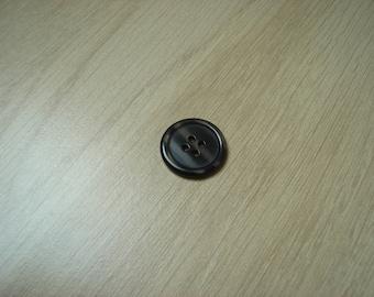 medium brown button with RIM