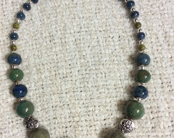 Glazed ceramic beaded necklace in shades of the sea