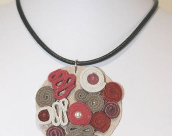 Leather pendant with semi-precious stones.