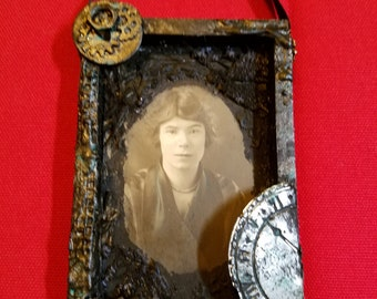 Vintage photo in handcrafted Steampunk frame
