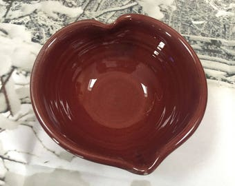 Red heart shaped ceramic handmade bowl by Ruth Sachs