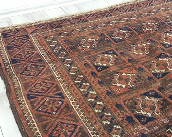 Antique Turkoman area rug Bokhara design brown and navy colors wool rugs