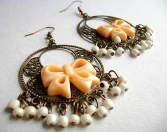 Bohemian style shabby chic  feminine chic peach bow and ivory little beads in antique bronze big earrings Oh my -