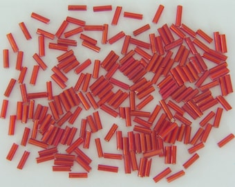 Bag of 19G approximately 600 glass seed beads red tube - free shipping