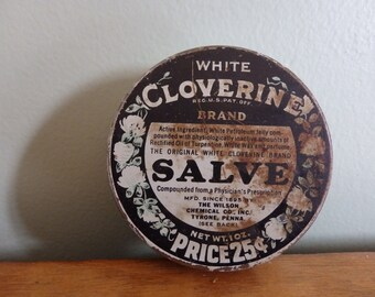 Vintage advertising tin, White Cloverine Brand Salve tin in vintage condition measures 2 1/2 inches across advertising piece.