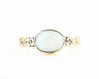 Antique Opal Ring, Bezel Set Oval Cabochon. Engraved Floral Band, 14k, Circa 1900.