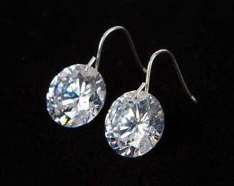 Brilliant cut cubic zirconia earrings  with sterling silver hooks. Buy two pairs and get free shipping! They also come in square!!