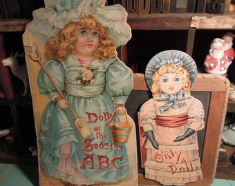 """Vintage Doll Books / """"Only a Doll"""" / Helen Marion Burnside / """" Dolly at The Seaside """" ABC Book / Father Tuck's / Two Doll Shaped Books"""