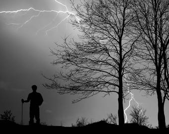Thunderstorm Watcher, Hiker Standing on Mountain Ridge Watching Thunderstorm, Tree Silhouette, Lightning Strike and Storm Clouds