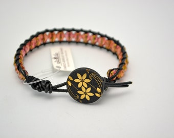 Woven Bracelet-Oriental Flair II. Black and Gold Flowered Button Clasp on Handmade Woven Bracelet w/ Gold Beads, Black Leather, & Silk Cord.