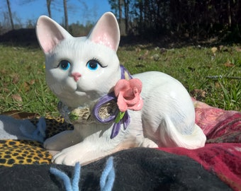 Avalo Sanctuary's Cat with a Rose