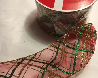 Sheer red w/ green and gold glitter argyle striped ribbon 2.5 inches wide, each roll is 25 ft. long
