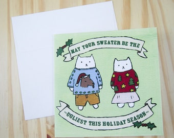 """CARD: """"Ugly Sweater Cats"""" featuring two cats wearing ugly Christmas sweaters"""