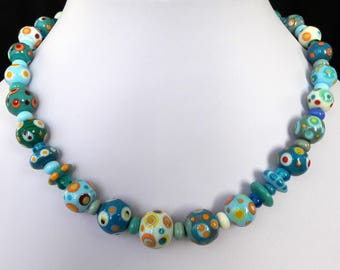 Turquoise, blue and mango lampwork glass bead necklace with hand made sterling silver clasp.