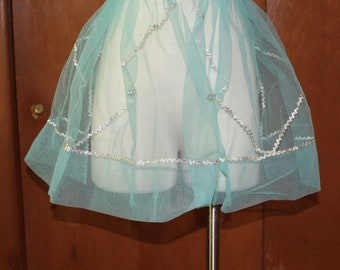 Vintage apron, 1950's.  Blue net with silver, and bells!