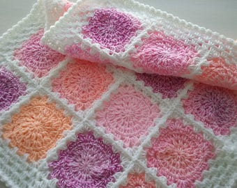 Baby blanket Crocheted in a Granny square design in colours shades of Pink and white.