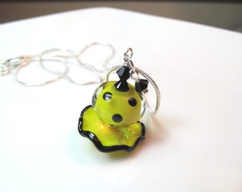 Necklace yellow & black ruffle and polka dot glass lampwork beads, black crystals