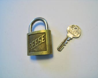 Vintage brass padlock with key. Reese. collectable brass lock and key