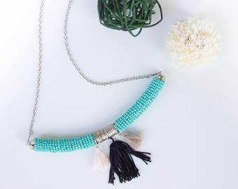 Ethnic necklace with tassels and beads