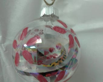 Glass ornament painted with recycled materials inside