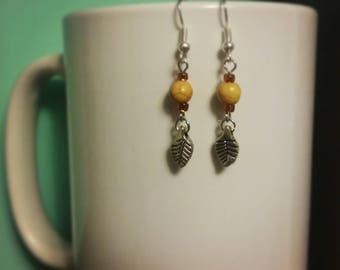 Silver leaf charm earrings with yellow bead