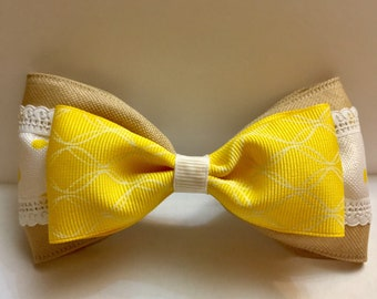 Tan, yellow, and white boutique bow