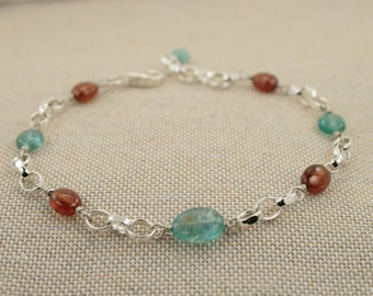 bracelet  with sterling silver chain and orange garnet spessartite blue apatite stones