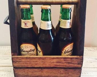 Rustic wooden beer carrier with opener