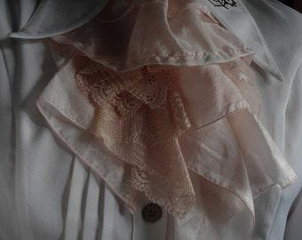 pale pink fabric and lace jabot